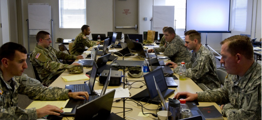A group of U.S. Army Reserve and National Guard cyber Soldiers work together to defend their network during Cyber Shield 17 at Camp Williams, Utah, May 2, 2017.