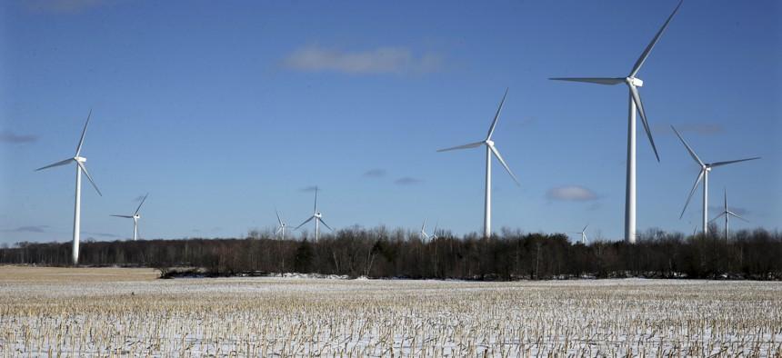 Large energy producing wind turbines that make up Noble Ellenburg Windpark are seen on a harvested cornfield on a farm Sunday, Jan. 15, 2017, in Ellenburg, N.Y.