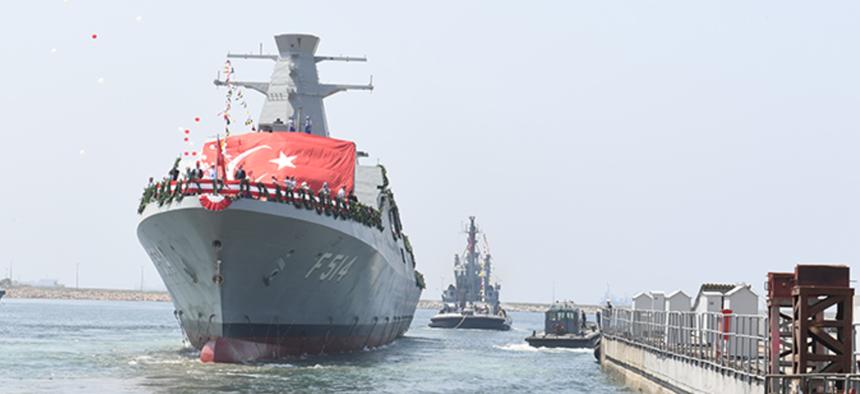 TCG Kinaliada, an Ada-class corvette, slides down the ways at Turkey's Tuzla Naval Shipyard on July 3, 2017