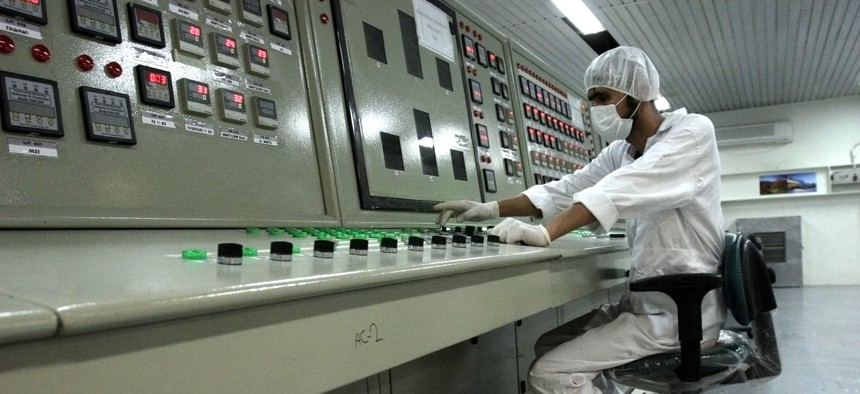an Iranian technician works at the Uranium Conversion Facility just outside the city of Isfahan 255 miles (410 kilometers) south of the capital Tehran, Iran, Feb. 3, 2007.