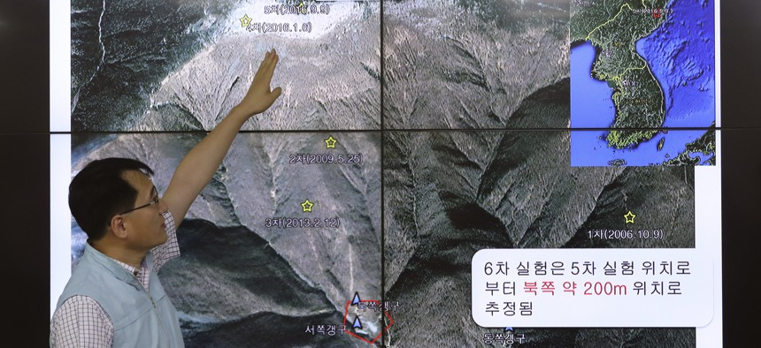 Earthquake and Volcano of the Korea Monitoring Division Director Ryoo Yong-gyu speaks in front of a screen showing about artificial earthquake in North Korea, in Seoul, South Korea, Sunday, Sept. 3, 2017.