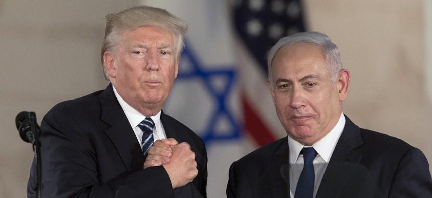 In this May 23, 2017, file photo, U.S. President Donald Trump and Israeli Prime Minister Benjamin Netanyahu shake hands at the Israel museum in Jerusalem.