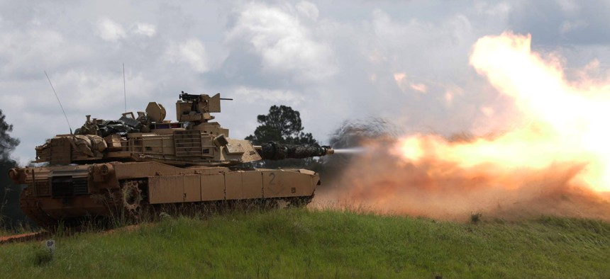 A tank crew, assigned to 1st Armored Brigade Combat Team, 3rd Infantry Division, fires at a target during qualifications exercises at Fort Stewart, Ga., Aug. 8, 2017.