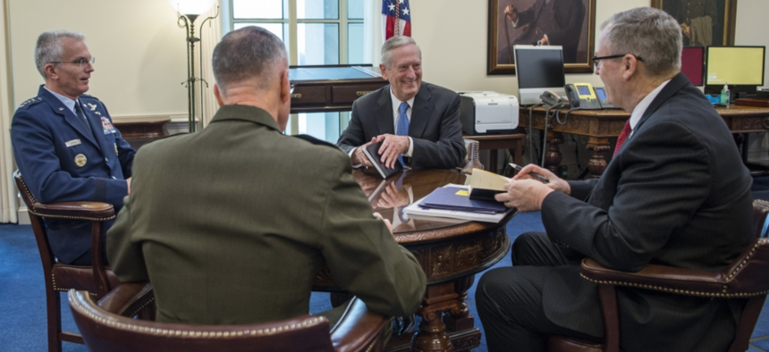 Defense Secretary James Mattis meets with other senior military and defense leaders earlier this year.
