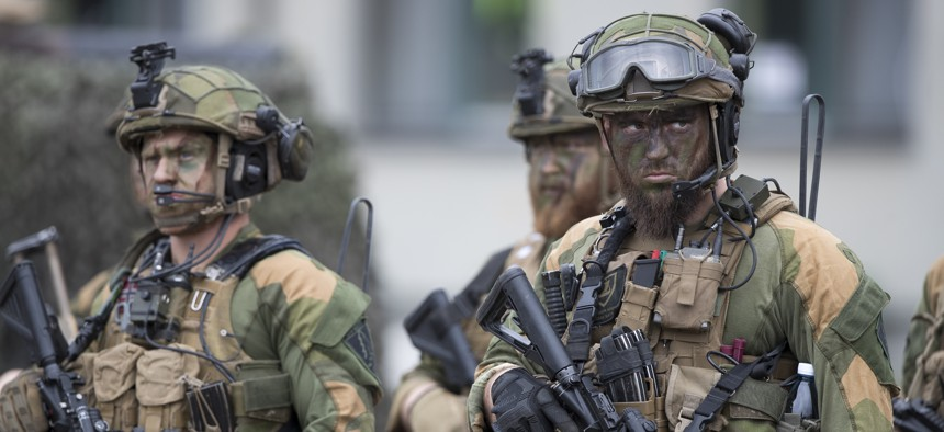 Norwegian soldiers of the NATO enhanced forward presence battalion attend a German President Frank-Walter Steinmeier welcome ceremony at the Rukla military base some 130 kms (80 miles) west of the capital Vilnius, Lithuania, Friday, Aug. 25, 2017.