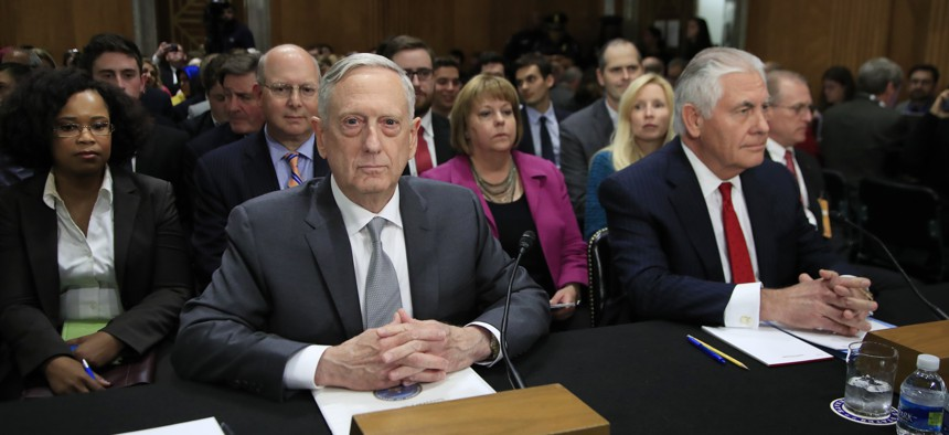 Secretary of Defense Jim Mattis and Secretary of State Rex Tillersonare seated during a Senate Foreign Relations Committee hearing on Capitol Hill in Washington, Oct. 30, 2017.