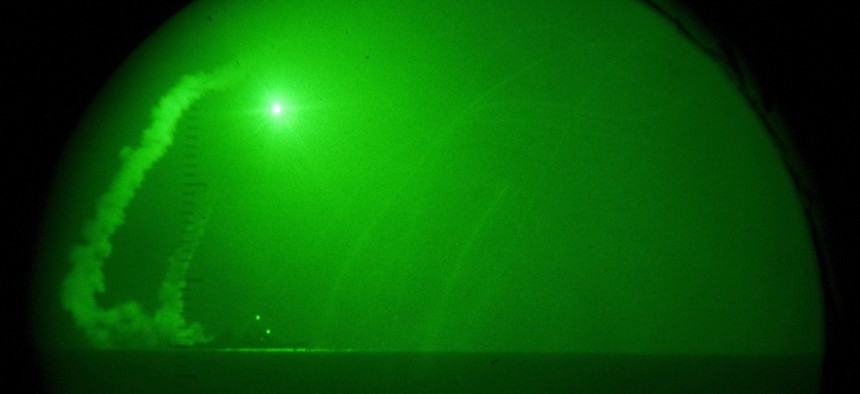 Guided missile destroyer USS Barry (DDG 52) fires Tomahawk cruise missiles in support of Operation Odyssey Dawn, March 19, 2011.