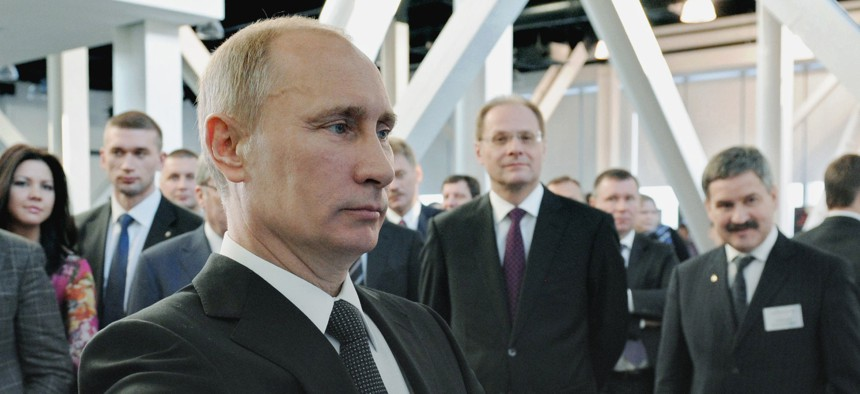 Russian Prime Minister Vladimir Putin visits a science and technology exhibit in Novosibirsk, about 2800 kilometers (1,750 miles) east of Moscow, Russia, Friday, Feb. 17, 2012.