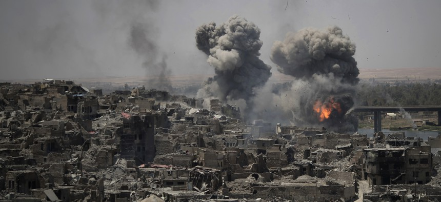 """Airstrikes target Islamic State positions on the edge of the Old City a day after Iraq's prime minister declared """"total victory"""" in Mosul, Iraq, July 11, 2017."""