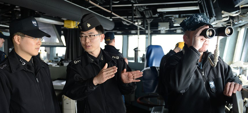 U.S. andRepublic of Korea Navyofficers inside theguided-missile destroyer USS McCampbell (DDG 85), in waters west of the Korean Peninsula, March 16, 2013.