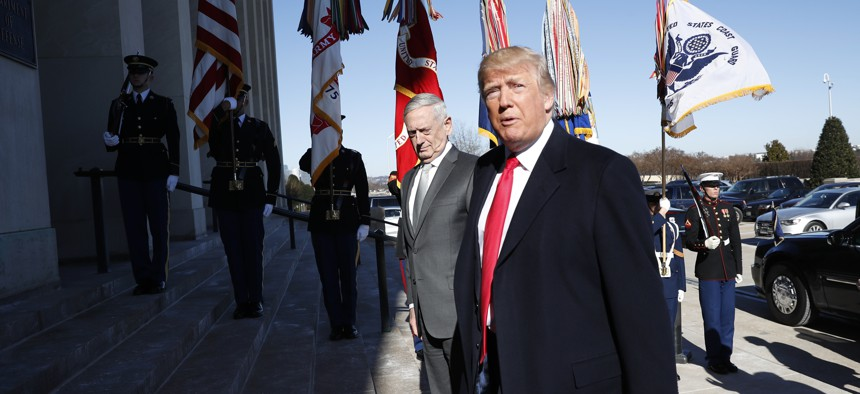 President Donald Trump walks into the Pentagon with Defense Secretary Jim Mattis on his arrival to the Pentagon, Thursday, Jan. 18, 2018.