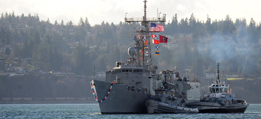 The Oliver Hazard Perry-class frigate USS Rodney M. Davis (FFG 60) returns to homeport at Washington state's Naval Station Everett,Dec. 19, 2014, ahead of decommissioning in 2015.