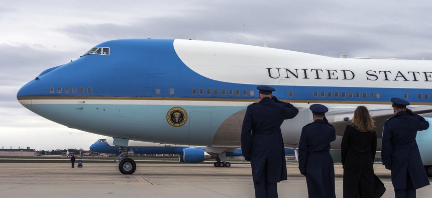 Airmen salute as Air Force One departs Joint Base Andrews.
