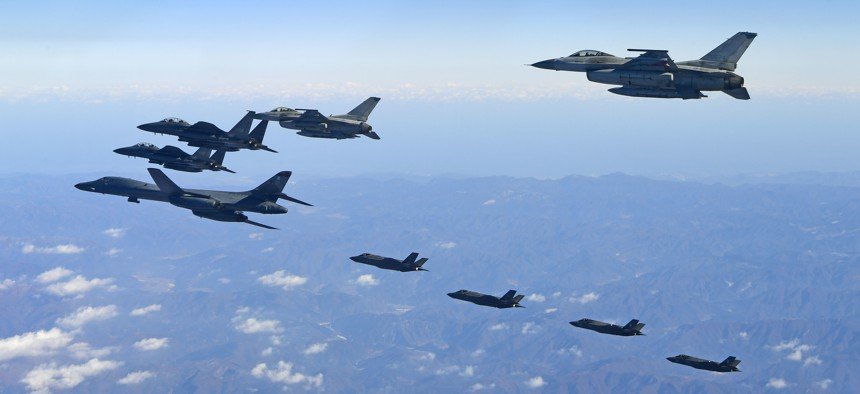 A U.S. Air Force B-1B bomber and South Korea and U.S. fighter jets fly over the Korean Peninsula during the combined aerial exercise, South Korea, Wednesday, Dec. 6, 2017.