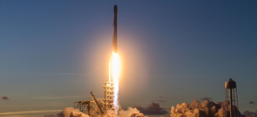 A SpaceX Falcon 9 rocket launchs the Echostar 105/SES-11 communications satellite from NASA's Kennedy Space Center.
