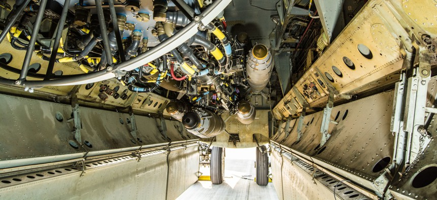 A U.S. B-52 Bomber sits on a flightline with munitions loaded on a newly installed conventional rotary launcher in its bomb bay, at Al Udeid Air Base, Qatar, Nov. 17, 2017.
