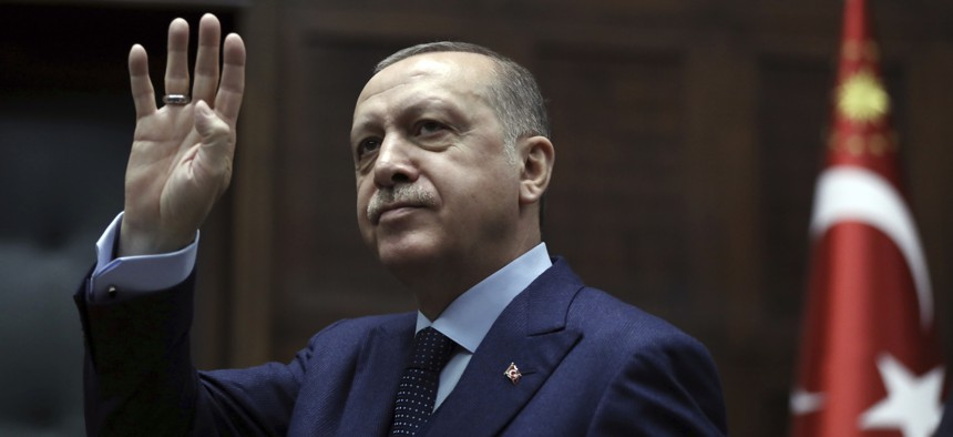 Turkey's President Recep Tayyip Erdogan waves to members of his ruling party at the parliament in Ankara, Turkey, Tues., Jan. 30, 2018.