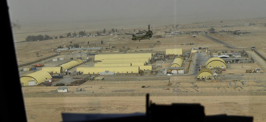A CH-47 Chinook flies over a Forward Operating Base in Afghanistan Feb. 15, 2018.