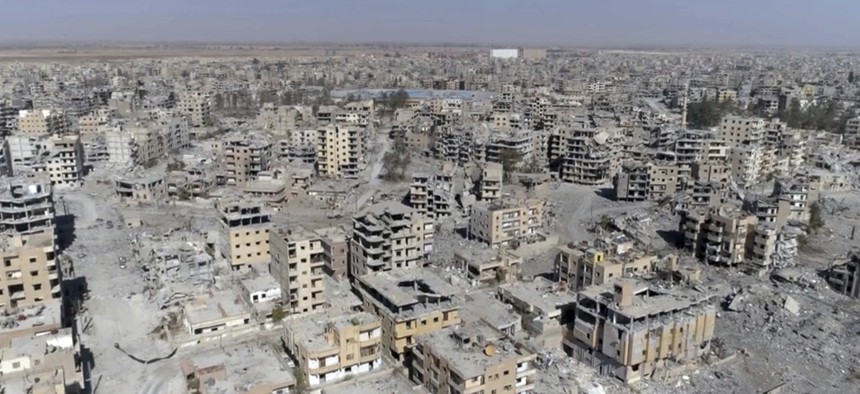 A frame grab made from drone video shows damaged buildings in Raqqa, Syria, Oct. 19, 2017.