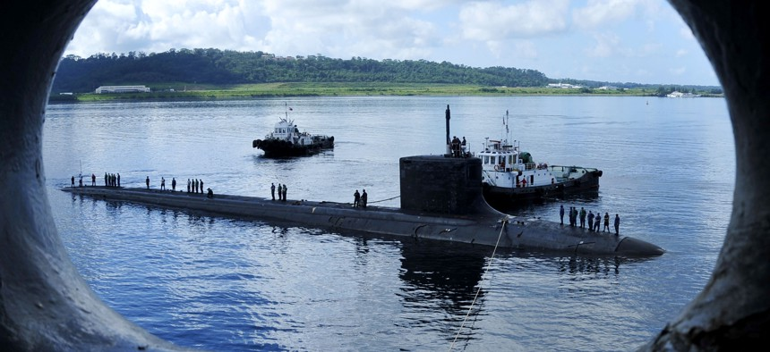 In this 2011 file photo, the Virginia-class fast attack submarine USS Texas (SSN 775) executes a tended mooring alongside submarine tender USS Emory S Land (AS 39) in Subic Bay, Philippines.