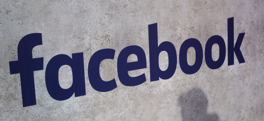 This Jan. 17, 2017, file photo shows a Facebook logo being displayed in a start-up companies gathering at Paris' Station F, in Paris.