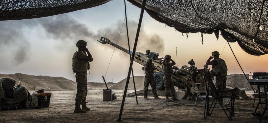 Soldiers fire an M777 towed 155 mm howitzer to support Iraqi security forces in northern Iraq, Aug. 15, 2017, while supporting Operation Inherent Resolve. The soldiers are paratroopers assigned to the 319th Airborne Field Artillery Regiment.