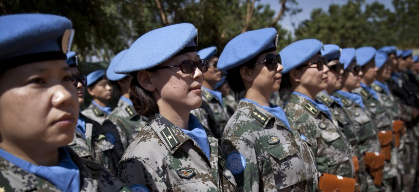 UN peacekeepers from China stand at attention during the 2014 visit of the leader of the UN Multidimensional Integrated Stabilization Mission in Mali (MINUSMA), at the Chinese camp in Gao.