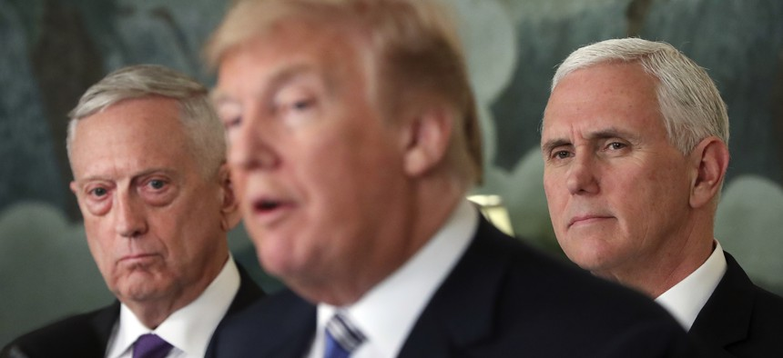 Defense Secretary Jim Mattis, left, and Vice President Mike Pence, right, listen to President Donald Trump, center, in the White House in Washington, March 23, 2018.
