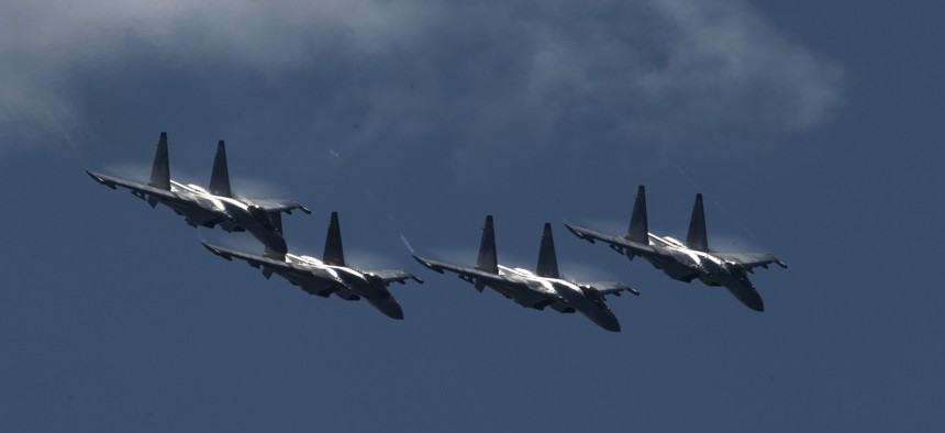 Russian Su-35s are reported being equipped with an AI-driven targeting device. Here, Su-35s perform at an air show outside Moscow in July 2017.