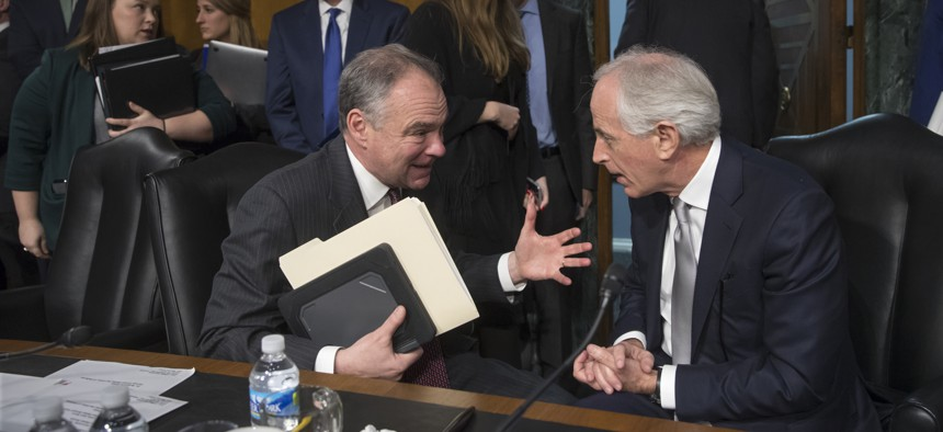 Senate Foreign Relations Committee Chairman Sen. Bob Corker, R-Tenn., right, confers with committee member Sen. Tim Kaine, D-Va. on Capitol Hill in Washington on Jan. 11, 2017.
