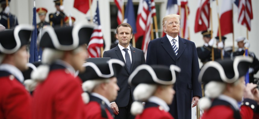 President Donald Trump and French President Emmanuel Macron stand during a State Arrival Ceremony on the South Lawn of the White House in Washington, Tuesday, April 24, 2018.