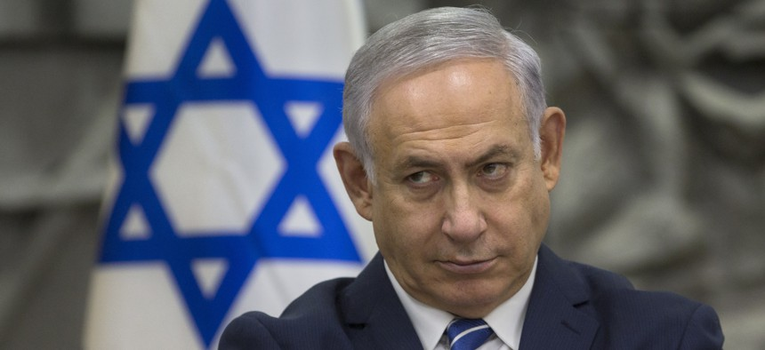 Israeli Prime Minister Benjamin Netanyahu attends a special cabinet meeting in the southern Israeli city of Dimona, March 20, 2018.