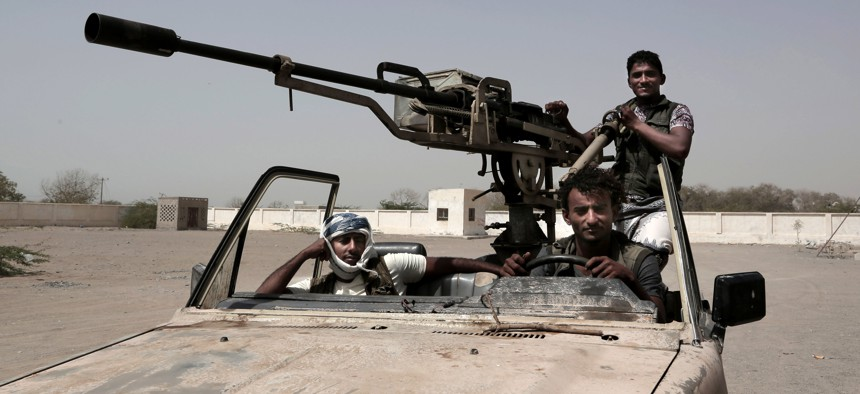 In this Feb. 12, 2018 photo, young Saudi-led backed forces, part of Ahmed Al-Kawkabani's southern resistance unit in Hodeida, patrol al-Khoukha, Yemen. Young men, some as young as 12, have served on the front lines throughout Yemen's 3-year-old war.