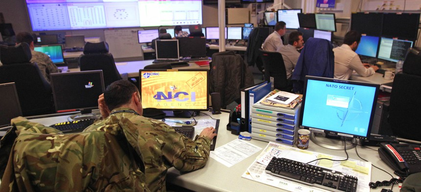 Staff operate at the NATO Computer Incident Response Capability (NCIRC) technical center, at NATO's military headquarters SHAPE in Mons, southwestern Belgium, Tuesday, Dec. 10, 2013.