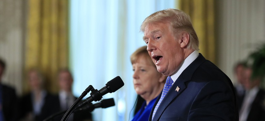 President Donald Trump and German Chancellor Angela Merkel speak during a news conference in the East Room of the White House in Washington, Friday, April 27, 2018.