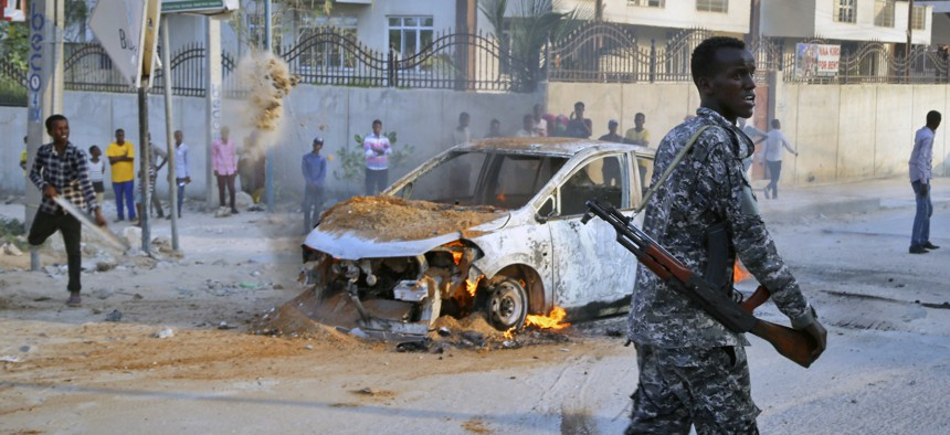 A Somali soldier attends the scene after a bomb attack near the office of the International Committee of the Red Cross in Mogadishu, Somalia Wednesday, March 28, 2018.