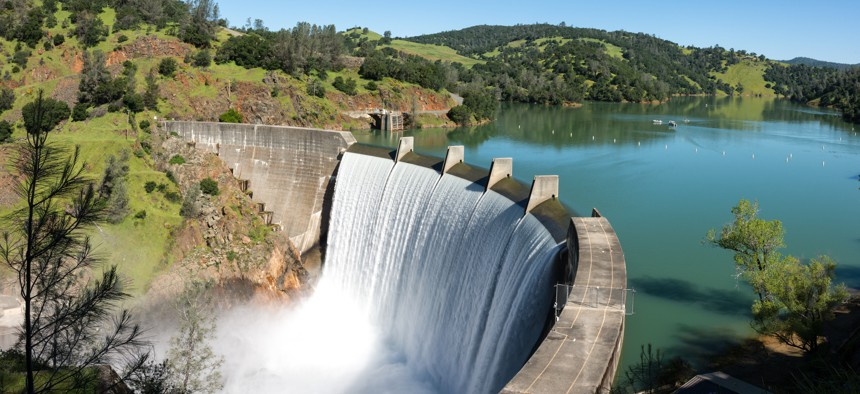 Water spills over the top of Englebright Dam on the Yuba River in California.