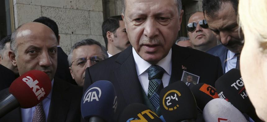 Turkish President Recep Tayyip Erdogan speaks to the media members at the parliament in Ankara, Turkey, Tuesday, March 20, 2018.