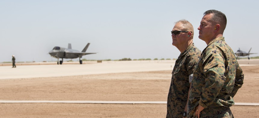 Commandant of the Marine Corps, Gen. Robert B. Neller (left), and Brigadier Gen. Rick Uribe (right), the deputy commanding general of 1st Marine Expeditionary Force, observe an F-35B at Naval Air Station El Centro, California, June 9, 2018.