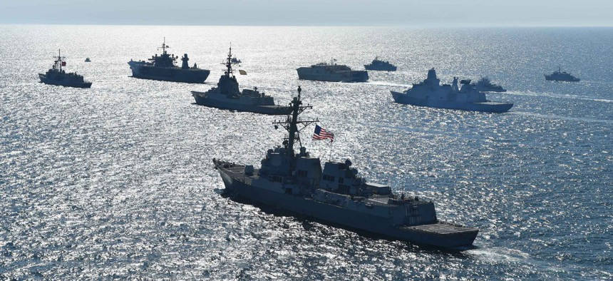 Thirty maritime unit ships from 12 nations maneuver in close formation for a photo exercise during Exercise Baltic Operations (BALTOPS) 2018 in the Baltic Sea.