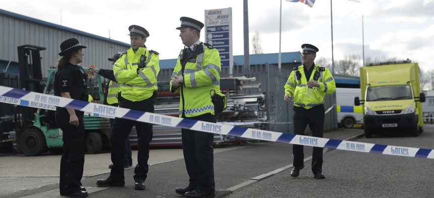 """olice officers secure a cordon outside the vehicle recovery business """"Ashley Wood Recovery"""" in Salisbury, England, Tuesday, March 13, 2018."""