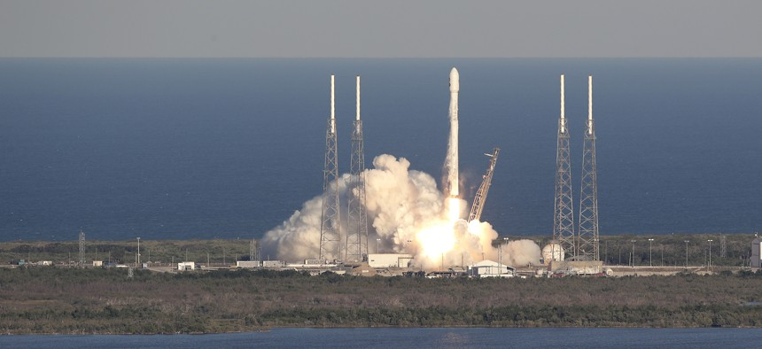 A SpaceX Falcon 9 rocket transporting the Tess satellite lifts off from launch complex 40 at the Cape Canaveral Air Force Station in Cape Canaveral, Fla., Wednesday, April 18, 2018.