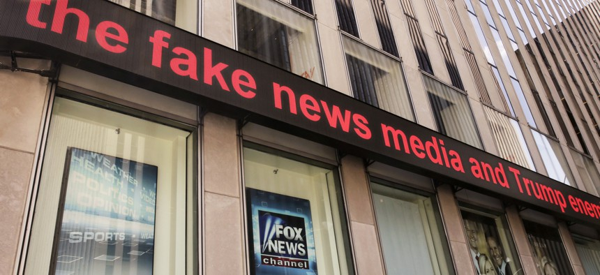 News headlines scroll above the Fox News studios in the News Corporation headquarters building in New York, Tuesday, Aug. 1, 2017. Fox contributor Rod Wheeler, who worked on the Seth Rich case, claims Fox News fabricated quotes implicating Rich.
