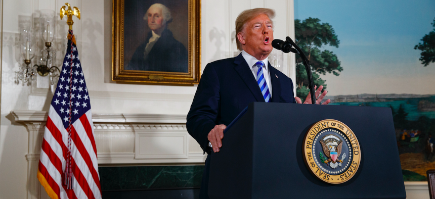 President Donald Trump delivers a statement on the Iran nuclear deal from the Diplomatic Reception Room of the White House, Tuesday, May 8, 2018, in Washington.