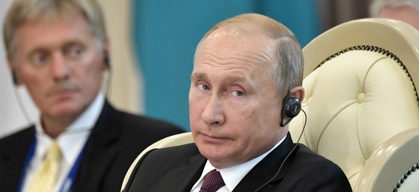 ussian President Vladimir Putin and presidential spokesman Dmitry Peskov, left, attend a meeting during the 5th Caspian summit in Aktau, the Caspian Sea port in Kazakhstan, Sunday, Aug. 12, 2018.