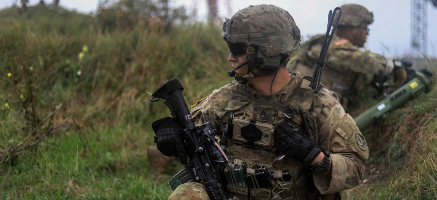 Army Staff. Sgt. Phillip Cox, foreground, communicates with his headquarters leadership team during an air assault training exercise as part of Noble Partner 18 at Camp Norio Training Area, Norio, Georgia, Aug. 9, 2018.