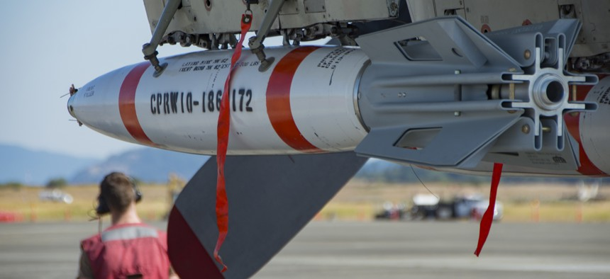 A Mark-63 Quickstrike Mine is mounted on a P-3 Orion aircraft at Oak Harbor, Washington, on July 25, 2018.