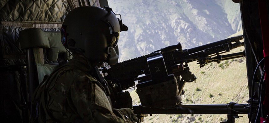 A U.S. Army CH-47 Chinook helicopter crew chief assigned to Task Force Flying Dragons, 16th Combat Aviation Brigade, 7th Infantry Division scans below near Mazar-e-Sharif, Afghanistan.