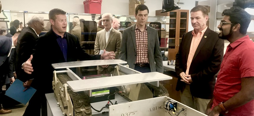 U.S. Army Undersecretary Ryan McCarthy, Army Vice Chief of Staff Gen. Jim McConville a University of Texas at Austin 3D printing lab, Thursday, August 23, 2018.