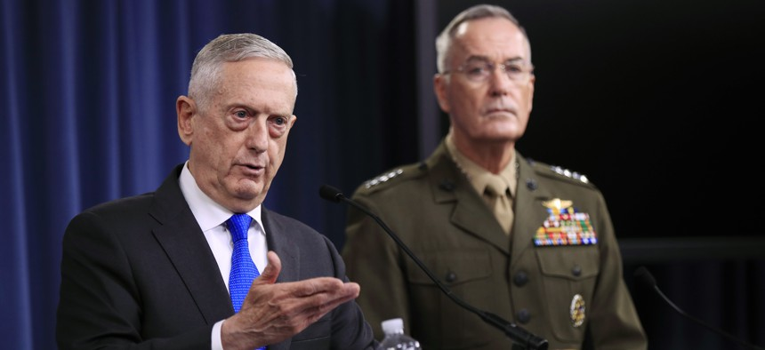 Secretary of Defense Jim Mattis, left, and Chairman of the Joint Chiefs of Staff, Marine Gen. Joseph Dunford speak to reporters during a news conference at the Pentagon, Tuesday, Aug. 28, 2018 in Washington.